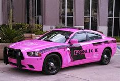The Orlando Police Department presented Officer Karen Long with a pink Dodge Charger patrol car to honor her fight with cancer and in support of Breast Cancer Awareness Month on Oct. American Graffiti, Harrison Ford, Breast Cancer Support, Breast Cancer Awareness, Radios, 4x4, Automobile, Pt Cruiser, Exotic Sports Cars