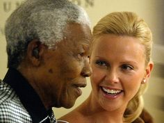 Nelson Mandela with actress Charlize Theron, the first South African (and African)woman to win an Oscar.