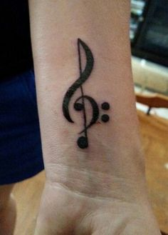 One example of a beautiful tattoo that depicts one's love for music is the treble clef tattoo. The treble clef refers to the musical symbol that is used by musicians in the form of notations.