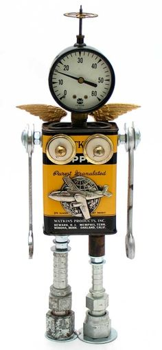 """""""Amelia Gearbot""""   Height: 12""""   Principal Components: Spice tin, pressure gauge, wrenches, hose fittings, drawer pull parts, clock gear, pin"""