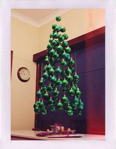 Suspension Christmas tree. Made with christmas ball ordimants and hung from fishing wire. VERY cool idea!!!