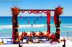 Tangerine Mandap for a lavish beach wedding Indian Beach Wedding, Indian Destination Wedding, Indian Wedding Planner, Dubai Wedding, Wedding Mandap, Destination Wedding Inspiration, Wedding Stage, Destination Weddings, Beach Weddings
