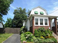 MOVE-IN CONDITION! GREAT HOME WITH ENCLOSED FRONT PORCH ON 1ST FLOOR. LIVING ROOM, DINING ROOM, KITCHEN WITH CENTER ISLAND, & MAIN BATH. 2 BEDROOMS UPSTAIRS. NEW CENTRAL AIR. FULL BASEMENT & 1 CAR DETACHED GARAGE.GREAT YARD! HOME IS IN GREAT SHAPE.