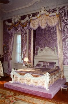 Alva Vanderbilt's bed. Marble House, Newport, RI. Mrs. Vanderbilt's Bedroom, on the second floor, is in the Louis XIV style. The ceiling in this room is adorned with circular ceiling painting of Athena, painted circa 1721 by Giovanni Antonio Pellegrini. It was originally in the library of the Palazzo Pisani Moretta in Venice.