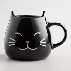 The perfect gift for animal lovers, our exclusive stoneware coffee mug looks like a happy cat with perky raised ears, a pink nose and adorable black whiskers.