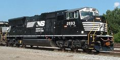 """Whiteface: first version of Norfolk Southern's """"Horsehead"""" paint scheme. High visibility paint scheme used on various Burlington Northern locomotives, primarily SD60Ms, SD40-2s, GP50s, GP39 rebuilds, and GP28 rebuilds."""