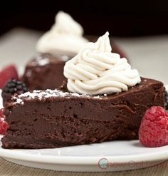 Flourless Chocolate Cake with Kahlua Whipped Cream - Only one decadent dessert is designed with an intense chocolate demand in mind - it's this gluten free Flourless Chocolate Cake!