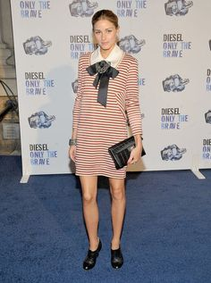 Olivia Palermo's 36 Best Dress Moments: Giving a soft minidress her signature styling treatment with open-toe booties and an evening jacket at Fashion Week in September '08.  : A cheeky striped mini in August '09.