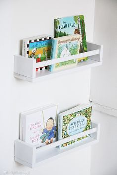 Ikea spice racks (3.99) as forward-facing bookshelves for my nursery! I could literally fill 20 of these!