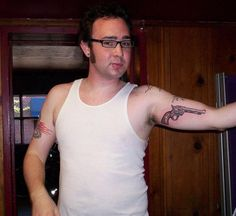 Gun Tattoo : Cool guy with a classy pistol tattoo on his bicep.