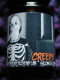 Creepy perfume oil from BPAL's Halloween 2009 collection. I want to have Creepy's BPAL babies. The evil looking bottle pic has nothing to do with how awesome this smells.