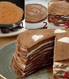 Torta torre de panqueques de chocolate. Preparar los panqueques con harina ,cacao,huevo y leche.Todo licuado.hacerlos un poco mas gruesos que lo usual.Rellenar con crema,o queso crema,frutas etc.