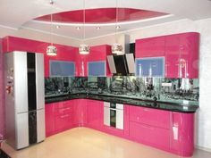Beautiful Kitchen Island with L Shaped Pink Kitchen Cabinet using Black Countertop Idea and Black Ceramic Backsplash Design and Drum Shaped Chrome Pendant Lamps and Silver Refrigrator and Lamps Pink Kitchen Cabinets, Glossy Kitchen, Kitchen Doors, Work Tops, Flat Illustration, Storage Cabinets, Beautiful Kitchens, Countertops, Kitchen Design