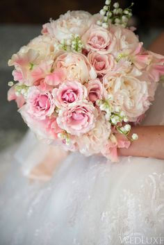 A Spring Wedding Filled with Cherry Blossoms and Pink Details  Cherry blossoms and pink details evoke the romance of spring at this spectacular wedding  Photography by: Storey Wilkins Photography
