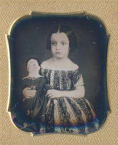 """Little girl with her doll, the doll's face had been """"painted over"""" and eyes had been etched in the silver (via Dennis A. Waters Fine Daguerreotypes)"""