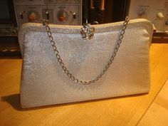 Adorable silver lame clutch/purse with silver clasp and chain. Can be used as either, as chain and latches tuck inside (i forgot to tuck in latches while photographing) Great vintage condition. Bridesmaid Clutches, Clutch Purse, Michael Kors Jet Set, Buy And Sell, Tote Bag, Wallet, Purses, Chain, Silver