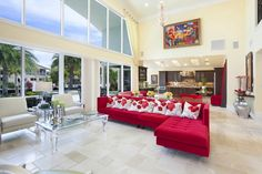 Red sofa and lucite table   | Usual House