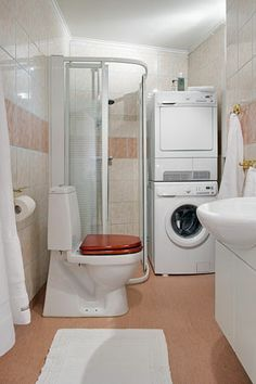 Ideas de c mo integrar la lavadora en un ba o ba o - Lavadora secadora pequena ...