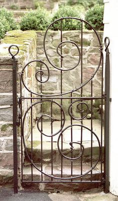 I have a thing for garden gates.  Love the curlicues on this one.
