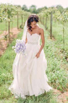 Soft lilac bouquet and a sweetheart neckline wedding dress
