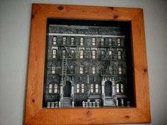 Led Zeppelin's Physical Graffiti carved into wood. Each brick, staircase and garbage can carved and painted by hand. - Front View  Work done by Bruce J Schmalfuss