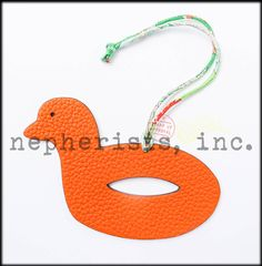 Hermes petit H leather charm in duck float design. New condition with Hermes box and ribbon.