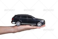 man holding a toy car ...  adult, auto, automobile, background, black, business, businessman, buy, car, concept, drive, give, giving, hand, hold, human, isolated, male, man, model, object, people, person, red, sale, salesman, sell, suit, toy, transport, transportation, travel, white