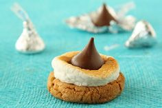 Smores Blossom Cookies--The classic peanut butter blossom cookies using cookie butter and toasted marshmallows..