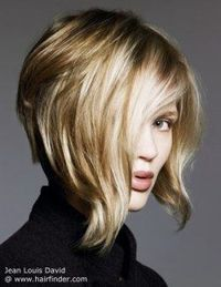 Blonde angled bob with a steep A-line. Sporty short hairstyle.