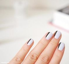 This minimalist manicure feels mod in classic black-and-white, but you could use any color for the stripe on the side of each nail. #NailArt #NailDesigns