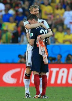 Classy Mertesacker consoles his defensive partner, Koscielny, after Germany defeats France #worldcup