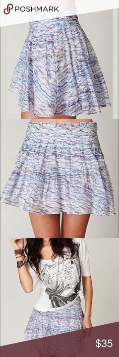 """HP Style Obsessions Free People Soft Mini Skirt $88 FREE PEOPLE Party Animal mini skirt.  Whimsical & gorgeous New without tags.  Sold out.    Features:   Multi-color, abstract stripe pattern with pleating and exposed metallic gold thread stitching design at waist , mid skirt, and hem.  Material is light and soft, almost gauze-like Invisible side zipper Fully lined in 100% cotton 65% rayon , 35% nylon  Machine wash cold  Approximate Measurements:  Waist: 30"""" Front Length: 14"""" Free People…"""