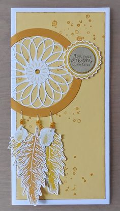 handmade card from little or much ... tall and thin #10 format ... dreamcatcher ... stamped and die cut feahers ... lacy die cut in a circle ... great card! ... Stampin' Up!