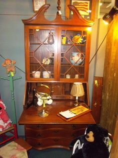 This hutch has a pull out desk makes me want to sit down and write or read! Positively beautiful!