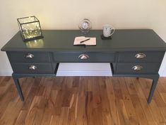 "STAG 5 drawer desk upcycled with Farrow & Ball ""Downpipe"" dark grey with brushed steel cup handles. Dressing Table Upcycled, 5 Drawer Dressing Table, Stag Furniture, Upcycled Furniture, Grey Table, Desk With Drawers, Farrow Ball, Sustainable Living, Office Desk"