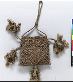 Bag Date: 17th century Culture: Italian (?) Medium: Macrame Dimensions: H. 5 x W. 5 1/2 inches 12.7 x 14.0 cm Classification: Textiles Credit Line: Gift of Mrs. Edward S. Harkness, 1930