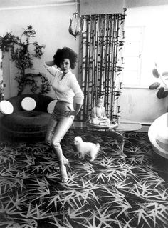 1964– Burlesque dancer Blaze Starr poses at her home in Baltimore, Maryland –photo by Diane Arbus