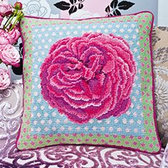 Kaffe's Rose, a striking needle point design from Kaffe Fassett featuring this pink summer flower.