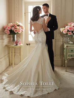Sophia Tolli - Y11629 – Rexana - Paris satin fit and flare wedding gown with lace slight cap sleeves, plunging V-neckline, hand-beaded lace appliqué bodice with dropped waist, lace keyhole back and back zipper both trimmed with diamante buttons, scalloped lace hem and chapel length train.  Sizes: 0 – 28  Colors: Alabaster Ivory, Ivory, White