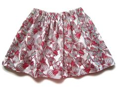 This pretty girls skirt has an unusual bird design, with tiny bird cages in shades of pink, white, and aqua blue.