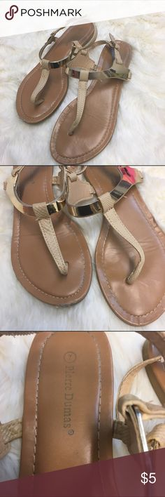 Pierre Dumas Gold / Neutral Sandals Pierre Dumas Gold / Neutral Sandals used but still life left. Slight wear on the front of the right shoe (see pic), but otherwise in good shape. Bundle and save! Pierre Dumas Shoes Sandals