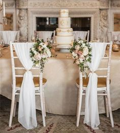 For some couples, simple isn't really their thing, and that's fine. If you're not so 'less is more' then you'll adore these seriously luxe-looking chairs, pictured at Weston Park. The fabric draping is chic on its own, but the addition of the flowers just Wedding Chair Sashes, Wedding Chair Decorations, Wedding Chairs, Wedding Table, Rustic Wedding, Trendy Wedding, Wedding Gifts, Wedding Reception, Dress Wedding