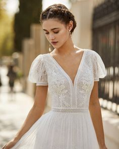Lightweight wedding dress in dot tulle and Chantilly lace. V-neckline and back, short puffed sleeves and dot tulle skirt with lace trim insets. Wedding Dress Trends, Dream Wedding Dresses, Bridal Dresses, Wedding Gowns, Wedding Ceremony, Lace Dress, White Dress, Plus Size Wedding, Dream Dress