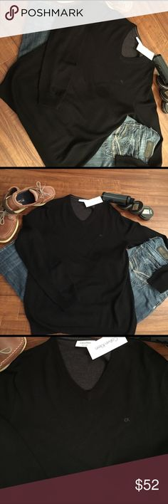 SEXY BLACK CK SWEATER😘NWT Stunning Black Calvin Klein Sweater. V-neck and so sexy and soft. No man could wear this and NOT look gook! NWT Calvin Klein Sweaters V-Neck