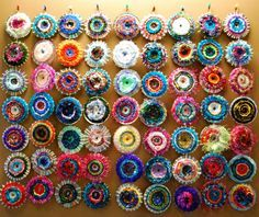 Amazing weavings on old CDs. What a great idea for the wall at the daycare in the older children's room. They could take them home at the end of summer!