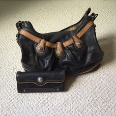Brighton Purse and Matching Wallet Both items are USED, these are still in good enough condition to be used by someone else. The third pictures shows all the flaws if you have questions about them feel free to ask or to make an offer! Brighton Bags