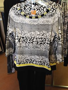 Black and white border print top with yellow beaded neckline.
