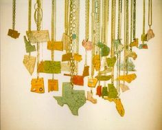 hang state map puzzle pieces as a mobile, as a fan pull, as anything.  Or even wear it as a necklace.