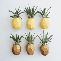 This pineapple air plant holder is made out of reclaimed wood and painted a tropical yellow. It has a very strong magnet attachment.  Very cute gift or home decor item. Size is approximately 2 x 1.5 x 1.5.  Since this is reclaimed wood, not all will look exactly like the photo. The pattern will vary slightly on each piece.  Price Includes the air plant & free ground shipping in the US.