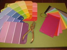 """use a binder ring to organize paint swatches. keep in art centre so students can use them to mix their own colours. then write """"recipe"""" cards (i. two squirts yellow, one blue, one white, etc) Coupon Binder Organization, Craft Closet Organization, Organizing Life, Household Organization, Organization Ideas, Paint Swatch Art, Paint Swatches, Office Supply Organization, Craft Supplies"""